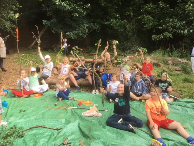 Children with their journey sticks they made during a forest school session